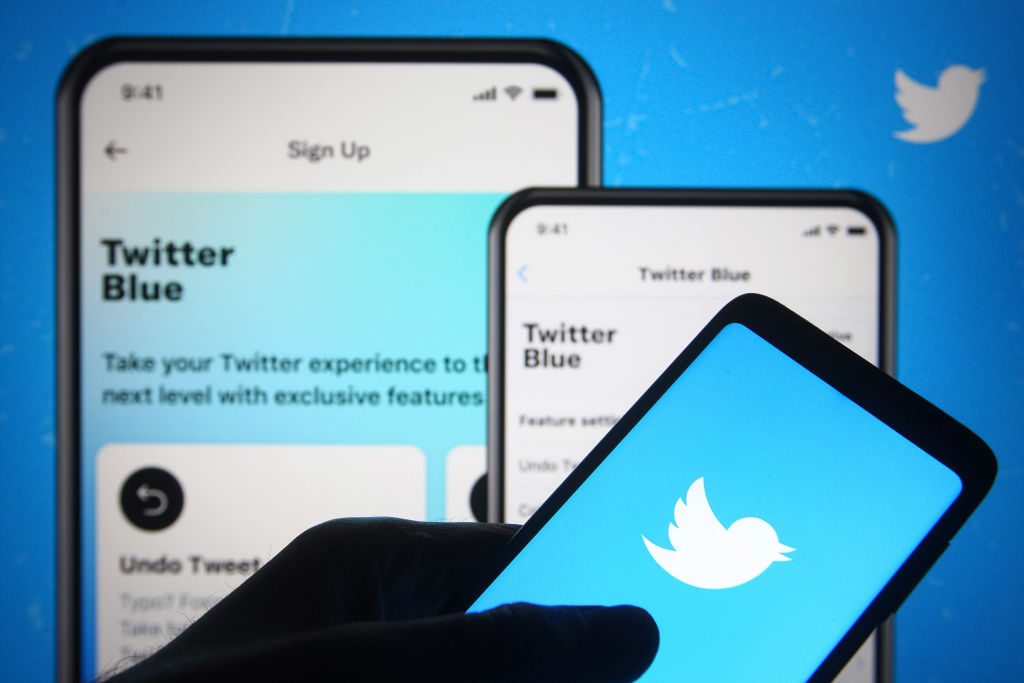 In this photo illustration, Twitter logo is seen on a